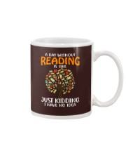 A Day Without Reading Mug tile