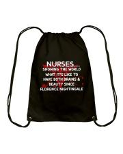 Nurse showing the world Drawstring Bag thumbnail