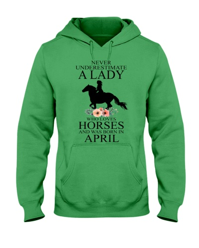 A lady who loves horses and was born in April