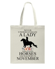 A lady who loves horses and was born in November Tote Bag thumbnail