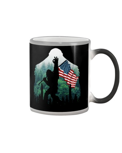 Bigfoot ok sign USA flag in the forest