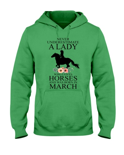 A lady who loves horses and was born in March