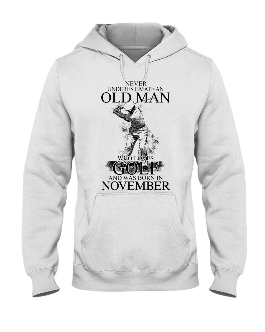 Never underestimate a man loves golf - November Hooded Sweatshirt