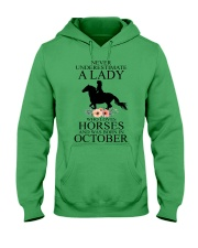 A lady who loves horses and was born in october Hooded Sweatshirt front