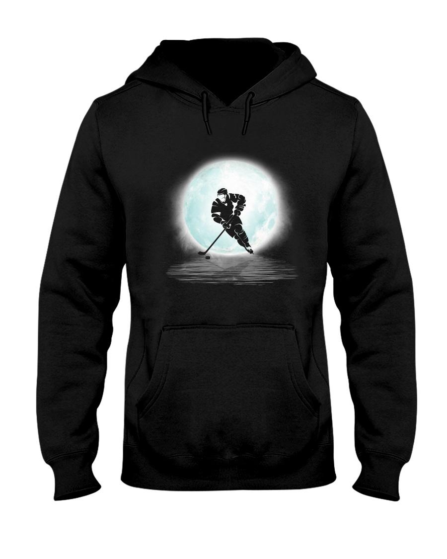 Playing hockey under the moon Hooded Sweatshirt