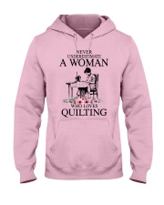 Never underestimate a woman who loves quilting Hooded Sweatshirt front