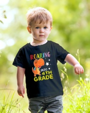 Dinosaur Roaring Into 4th Grade Youth T-Shirt lifestyle-youth-tshirt-front-5