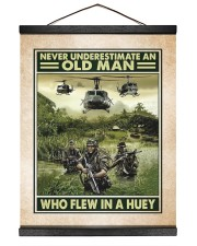 Never Underestimate An Old Man Who Flew In A Huey 16x20 Black Hanging Canvas thumbnail