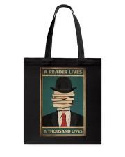 A READER LIVES A THOUSAND LIVES Tote Bag tile