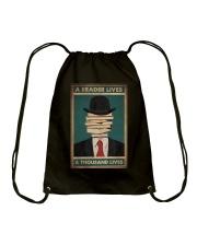 A READER LIVES A THOUSAND LIVES Drawstring Bag tile