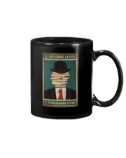 A READER LIVES A THOUSAND LIVES Mug tile
