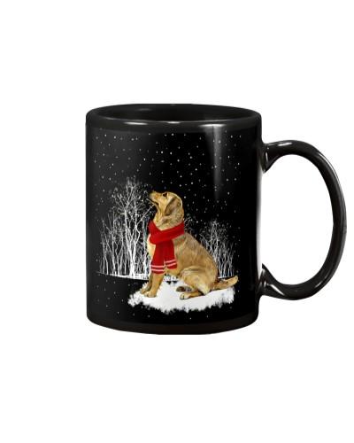 Golden retriever is watching the snow mug