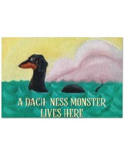 """A Dach-ness Monster Lives Here Doormat 22.5"""" x 15""""  front"""