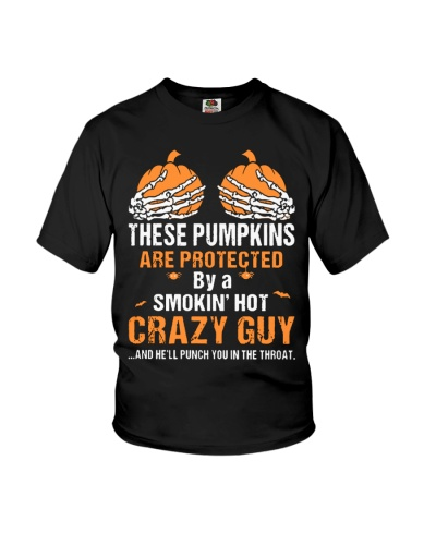These pumpkins are protected by a smokin crazy Guy