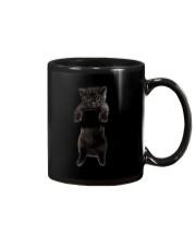Black cat and hand Mug thumbnail