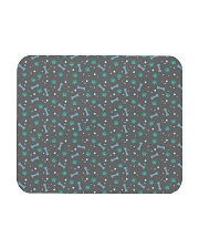 Seamless Pattern With Dog Paw Print and Bone Mousepad thumbnail