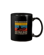 NEVER UNDERESTIMATE AN OLD MAN WITH A FISHING ROD Mug thumbnail