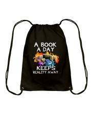 A book A day keeps reality away Drawstring Bag thumbnail