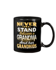 Between Grandma And Grandkids Mug front