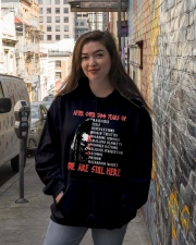 We are still here Hooded Sweatshirt lifestyle-unisex-hoodie-front-1
