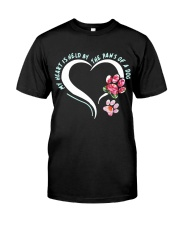 My heart is held by the paws of a dog Classic T-Shirt front