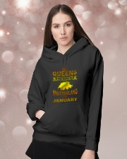 SWITZERLAND-GOLD-QUEES-JANUARY Hooded Sweatshirt lifestyle-holiday-hoodie-front-1
