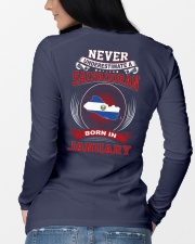 SALVADORAN-NEVER-UNDERESTIMATE-BORN-IN-JANUARY Long Sleeve Tee lifestyle-unisex-longsleeve-back-3