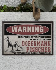 """Dobermann this property is protected Doormat 22.5"""" x 15""""  aos-doormat-22-5x15-lifestyle-front-01"""