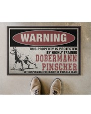 """Dobermann this property is protected Doormat 22.5"""" x 15""""  aos-doormat-22-5x15-lifestyle-front-04"""