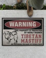 """Tibetan this property is protected Doormat 22.5"""" x 15""""  aos-doormat-22-5x15-lifestyle-front-01"""