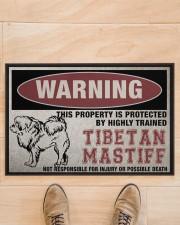 """Tibetan this property is protected Doormat 22.5"""" x 15""""  aos-doormat-22-5x15-lifestyle-front-02"""