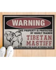 """Tibetan this property is protected Doormat 22.5"""" x 15""""  aos-doormat-22-5x15-lifestyle-front-03"""