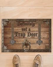 """Definitely Not A Trap Door Doormat 22.5"""" x 15""""  aos-doormat-22-5x15-lifestyle-front-02"""