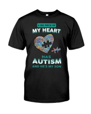 A big piece of my heart has autism and he's my son Premium Fit Mens Tee front