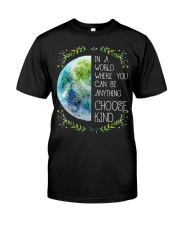Earth in the world where we can be anything choose Classic T-Shirt front