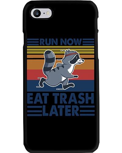 raccoon running run now eat trash