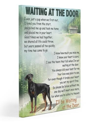 Doberman waiting at the door