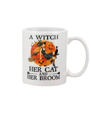 A Witch Her Cat and Her Broom Mug front