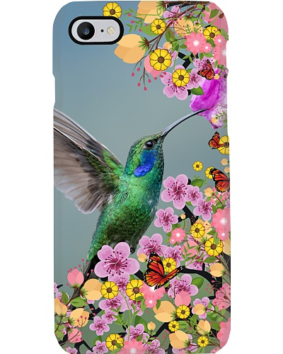 Green Hummingbird and Orange Butterflies