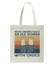 An Old Woman With Crocs Tote Bag thumbnail
