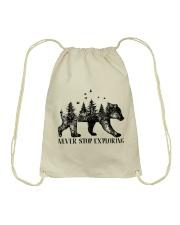 Never Stop Exploring Drawstring Bag thumbnail