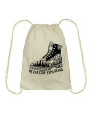 Never Stop Exploring Drawstring Bag thumbnail