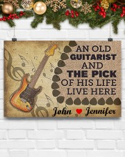 An Old Guitarist And The Pick 17x11 Poster aos-poster-landscape-17x11-lifestyle-28