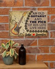 An Old Guitarist And The Pick 17x11 Poster poster-landscape-17x11-lifestyle-23