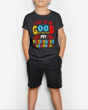 I take care of my firefighter grandpa  Youth T-Shirt lifestyle-youth-tshirt-front-1