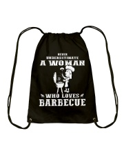 Never underestimate a woman Drawstring Bag thumbnail