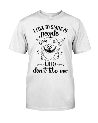 i like to smile at people who don't like me