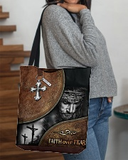 Faith over fear all over tote bag All-over Tote aos-all-over-tote-lifestyle-front-09