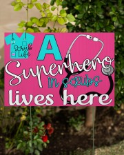 A Superhero In Scrubs Lives Here 18x12 Yard Sign aos-yard-sign-18x12-lifestyle-front-06
