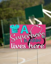 A Superhero In Scrubs Lives Here 18x12 Yard Sign aos-yard-sign-18x12-lifestyle-front-18